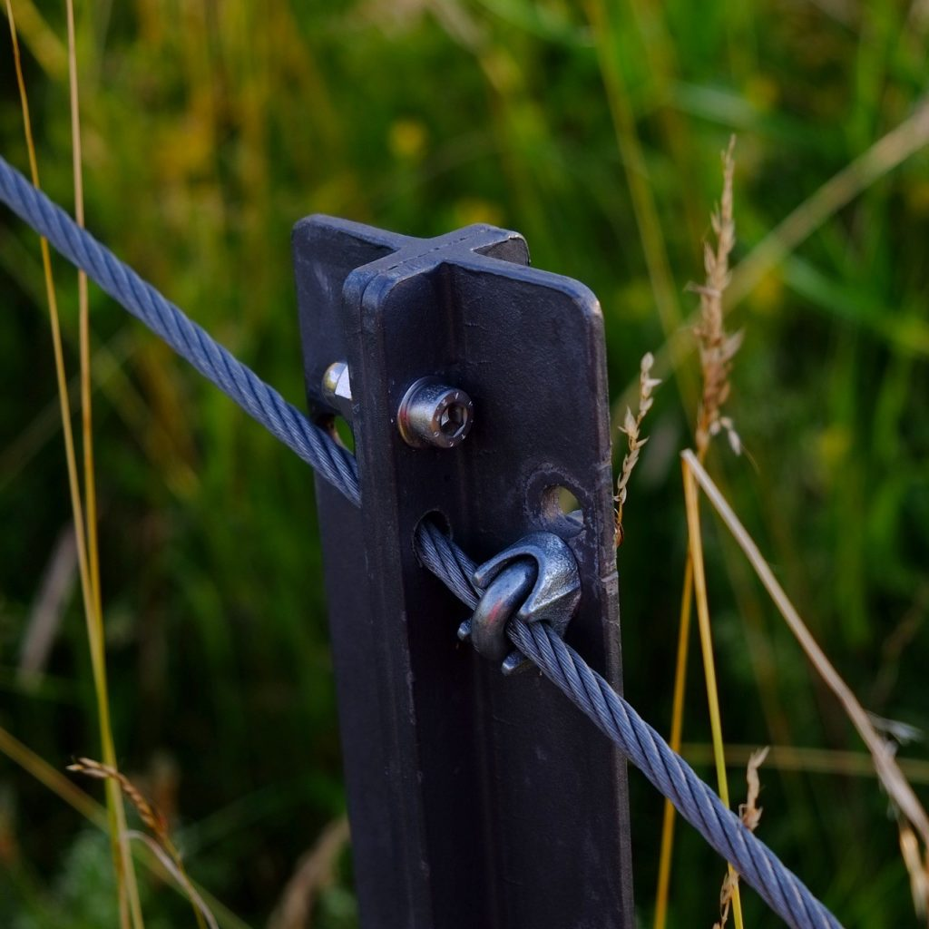 metal fence post with metal guide wire